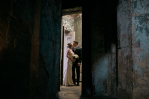 newlyweds kissing at the asylum